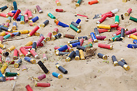 Fired shells lie in the sand after a shooting competition during the Cowboy Action Shooting European Championship in Dabas, Hungary on August 11, 2012. ATTILA VOLGYI