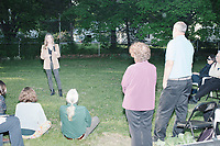 People listen as Democratic presidential candidate and spiritual guru Marianne Williamson speaks to a small crowd in the back yard of Kathleen O'Donnell at a campaign house party event in Keene, New Hampshire, on Wed., May 22, 2019.