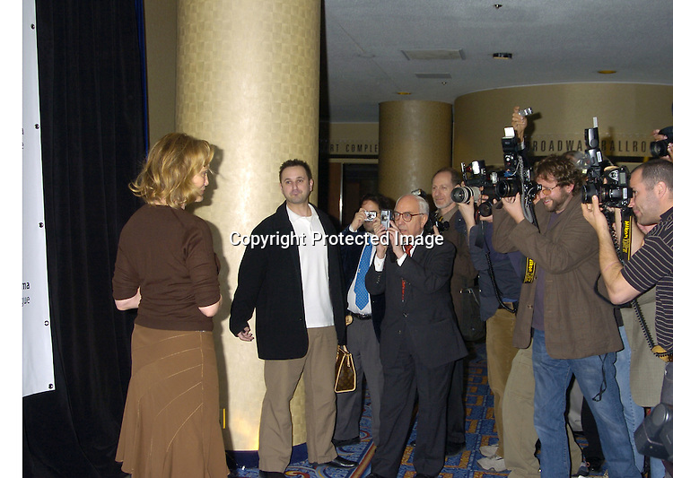 Jessica Lange with the photographers..at the 71st Annual Drama League Awards Luncheon on ..May 13, 2005 at the Marriott Marquis Hotel. ..Photo by Robin Platzer, Twin Images