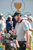 Marc Leishman (AUS) chats on the first tee during round 2 Four-Ball of the 2017 President's Cup, Liberty National Golf Club, Jersey City, New Jersey, USA. 9/29/2017.<br /> Picture: Golffile | Ken Murray<br /> <br /> All photo usage must carry mandatory copyright credit (&copy; Golffile | Ken Murray)