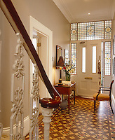 The Victorian entrance hall has a period tiled floor and stained glass around the front door