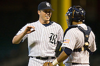 Jordan Rogers #31 of the Rice Owls is congratulated by catcher Diego Seastrunk #5 after getting the final out versus the Baylor Bears in the 2009 Houston College Classic at Minute Maid Park March 1, 2009 in Houston, TX.  The Owls defeated the Bears 8-3. (Photo by Brian Westerholt / Four Seam Images)