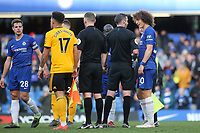 David Luiz of Chelsea has words with referee, Michael Oliver, at the final whistle during Chelsea vs Wolverhampton Wanderers, Premier League Football at Stamford Bridge on 10th March 2019