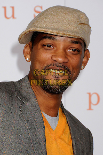 """WILL SMITH .2009 AFI Film Festival Premiere of """"Precious"""" held at Grauman's Chinese Theatre, Hollywood, California, USA, .1st November 2009..portrait headshot cap hat beard goatee facial hair yellow jumper sweater v-neck grey gray jacket beige diamond stud earrings .CAP/ADM/BP.©Byron Purvis/Admedia/Capital Pictures"""