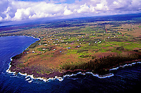 Homes sparsely dot the landscape on the black lava rock Puna coastline.