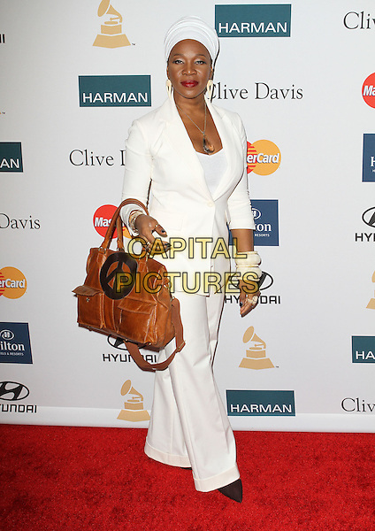India Arie.Attending Clive Davis And The Recording Academy's 2012 Pre-GRAMMY Gala Held at Beverly Hilton Hotel, Beverly Hills, California, USA, .11th February 2012..grammys party full length white suit trousers brown hands bag head scarf turban .CAP/ADM/KB.©Kevan Brooks/AdMedia/Capital Pictures.