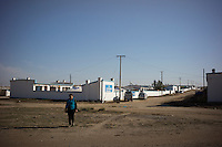 Mongolian Renqima walks outside her daily farm in Damao Banner, Inner Mongolia, China, October 2014.