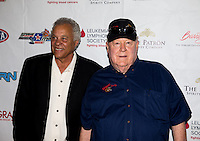 Aug. 29, 2013; Avon, IN, USA: NHRA NHRA former drivers Don Prudhomme  (left) and Tom McEwen on the red carpet prior to the premiere of Snake & Mongoo$e at the Regal Shiloh Crossing Stadium 18. Mandatory Credit: Mark J. Rebilas-