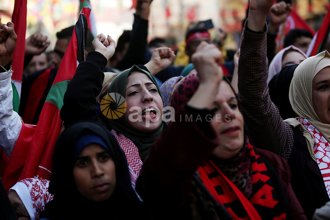 Palestinian supporters of the Popular Front for the Liberation of Palestine (PFLP) take part during a rally marking the 52nd anniversary of the founding of (PFLP) in Gaza City on December 7, 2019. Photo by Ashraf Amra