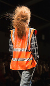 "Tuesday, 19 February 2013, London, UK. Ashish ""Working Girl"" catwalk show at Somerset House during London Fashion Week. Models dressed in overalls and high-viz vests/trousers with sequins and reflective stripes. Photo: Bettina Strenske"