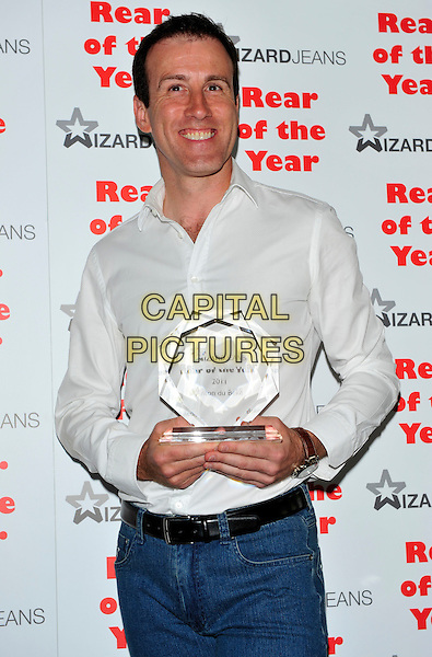 "Anton du Beke.Winner of the Male ""Wizzard Jeans"" Rear of the Year 2011, Dorchester Hotel, London, England..June 8th, 2011.half length jeans denim white shirt trophy winner award.CAP/CJ.©Chris Joseph/Capital Pictures."