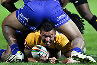 Picture by Alex Whitehead/SWpix.com - 04/11/2013 - Rugby League - Rugby League World Cup - Papua New Guinea v Samoa - Craven Park, Hull, England - PNG's Jason Chan is tackled by Samoa's defence.