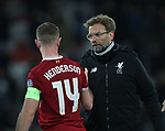 Jurgen Klopp manager of Liverpool greets Jordan Henderson of Liverpool during the Champions League Quarter Final 1st Leg, match at Anfield Stadium, Liverpool. Picture date: 4th April 2018. Picture credit should read: Simon Bellis/Sportimage