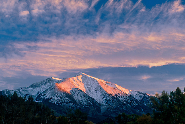 A sunset sky over Mount Sopris, a peak in the Maroon Bells-Snowmass Wilderness, near Carbondale & Aspen, Colorado.
