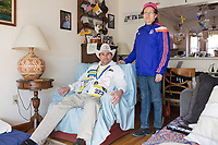 "Carlos Arredondo, 57, (left) and his wife Melida Arredondo, 52, are seen in their home in Roslindale, Boston, Massachusetts, USA, on Sat., March 31, 2018. Arredondo is well known as the ""man in the cowboy hat"" who helped out in the aftermath of the Boston Marathon Bombing in 2013. Carlos is wearing a jacket that he has used to create a t-shirt design for when he runs the Boston Marathon later this year. Though he has run the race unofficially previously, this will be the first time he runs it ""legally,"" he says."