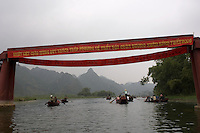 Banners over the River Yen announcing the annual Tet festival at the Perfume Pagoda.