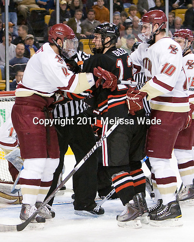 Tommy Cross (BC - 4), Randy Guzior (Northeastern - 13), Jimmy Hayes (BC - 10) - The Boston College Eagles defeated the Northeastern University Huskies 5-4 in their Hockey East Semi-Final on Friday, March 18, 2011, at TD Garden in Boston, Massachusetts.