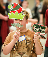 STAFF PHOTO ANTHONY REYES &bull; @NWATONYR<br /> George Skaggs, 10, of Springdale, dresses up for fun Friday, Dec. 5, 2014 during the Arkansas Virtual Academy's winter party at the Jones Center in Springdale. The event featured a number of games, crafts and a gingerbread house competition with prizes going to the winners in different age categories.