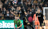 LOS ANGELES, CA - OCTOBER 29: Eduard Atuesta #20 of the Los Angeles FC heads ball during a game between Seattle Sounders FC and Los Angeles FC at Banc of California Stadium on October 29, 2019 in Los Angeles, California.