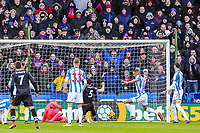 Crystal Palace's defender James Tomkins (5) scores the opening goal during the EPL - Premier League match between Huddersfield Town and Crystal Palace at the John Smith's Stadium, Huddersfield, England on 17 March 2018. Photo by Stephen Buckley / PRiME Media Images.