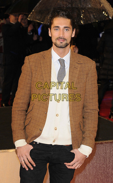 "Hugo Taylor.The ""G.I. Joe 2: Retaliation"" UK film premiere, Empire cinema, Leicester Square, London, England..March 18th, 2013.half length black suit white shirt tie grey gray cream cardigan goatee facial hair brown .CAP/CAN.©Can Nguyen/Capital Pictures."