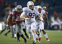 SEATTLE, WA - September 28, 2013: Stanford defensive end Josh Mauro returns an interception for a touchdown during play against Washington State at CenturyLink Field. Stanford won 55-17