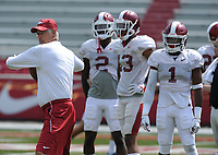 NWA Democrat-Gazette/ANDY SHUPE<br /> Arkansas defensive coordinator Paul Rhoads throws to members of the secondary Saturday, Aug. 5, 2017, prior to the start of a scrimmage in Razorback Stadium in Fayetteville. Visit nwadg.com/photos to see more photographs from the practice.