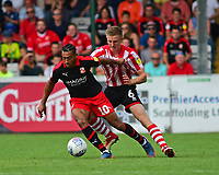 Lincoln City's Scott Wharton vies for possession with Swindon Town's Keshi Anderson<br /> <br /> Photographer Andrew Vaughan/CameraSport<br /> <br /> The EFL Sky Bet League Two - Lincoln City v Swindon Town - Saturday August 11th 2018 - Sincil Bank - Lincoln<br /> <br /> World Copyright &copy; 2018 CameraSport. All rights reserved. 43 Linden Ave. Countesthorpe. Leicester. England. LE8 5PG - Tel: +44 (0) 116 277 4147 - admin@camerasport.com - www.camerasport.com