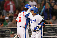 15 March 2009: #52 Tae Kyun Kim of Korea is congratulated by #10 Dae Ho Lee after scoring an homerun during the 2009 World Baseball Classic Pool 1 game 2 at Petco Park in San Diego, California, USA. Korea wins 8-2 over Mexico.