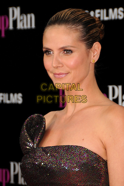 "HEIDI KLUM.""The Back-up Plan"" Los Angeles Premiere held at the Regency Village Theatre, Westwood, California, USA,.21st April 2010..arrivals portrait headshot hair scarped up back make-up beauty strapless brown shimmery shiny sparkly bronze gold pink purple sequined sequin green khaki.CAP/ADM/BP.©Byron Purvis/AdMedia/Capital Pictures."