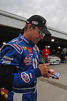 Mar 31, 2007; Martinsville, VA, USA; Nascar Nextel Cup Series driver Kyle Petty (45) signs an autograph during practice for the Goody's Cool Orange 500 at Martinsville Speedway. Martinsville marks the second race for the new car of tomorrow. Mandatory Credit: Mark J. Rebilas..