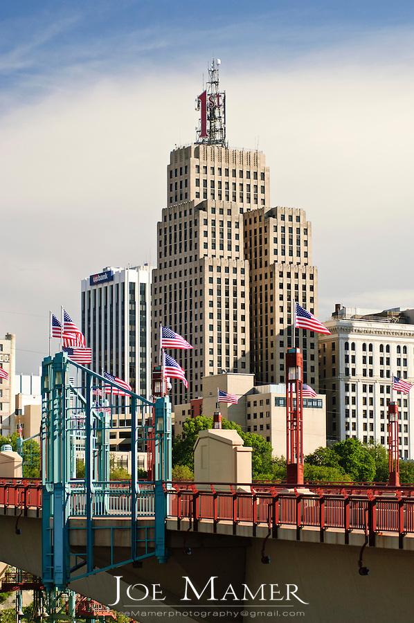 US flags line the Wabasha street bridge on a summer morning in downtown Saint Paul, Minnesota.