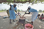 Women prepare food for the Loreto Primary School in Rumbek, South Sudan. The school is run by the Institute for the Blessed Virgin Mary--the Loreto Sisters--of Ireland. Children who come to the school eat twice a day, often the only food they get.