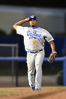 Daytona Cubs third baseman Jeimer Candelario (12) throws to first during a game against the Dunedin Blue Jays on April 16, 2014 at Florida Auto Exchange Stadium in Dunedin, Florida.  Dunedin defeated Daytona 5-1.  (Mike Janes/Four Seam Images)