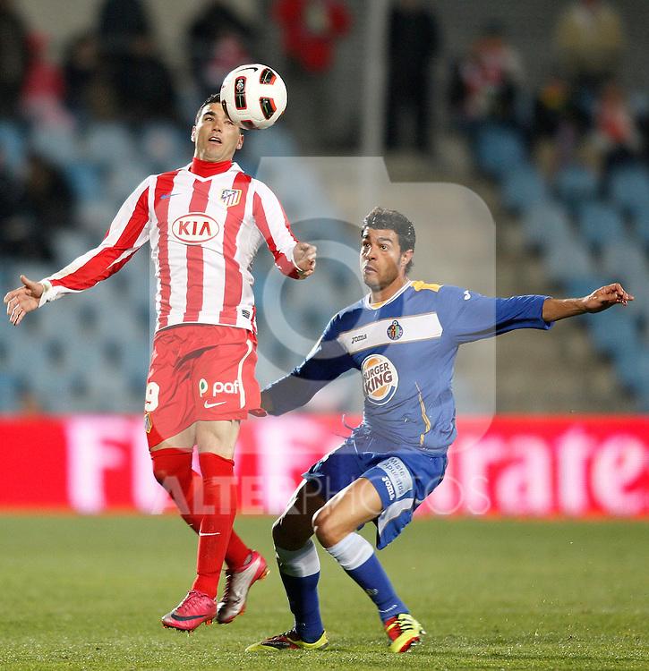 Atletico de Madrid's Jose Antonio Reyes against Getafe's Miguel Torres during La Liga Match. March 02, 2011. (ALTERPHOTOS/Alvaro Hernandez)