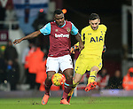 West Ham's Emmanuel Emenike tuslses with Tottenham's Hugo Lloris<br /> <br /> - English Premier League - West Ham Utd vs Tottenham  Hotspur - Upton Park Stadium - London - England - 2nd March 2016 - Pic David Klein/Sportimage