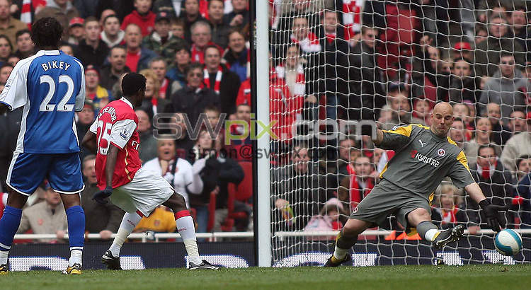 PICTURE BY JEREMY RATA/SWPIX.COM - Barclays Premier League Football - Arsenal v Reading - Emirates Stadium, London, England - 19/04/08. Arsenals Emmanuel Adebayor scores the opening goal past Readings Marcus Hanemann ..Copyright - Simon Wilkinson - 07811267706..