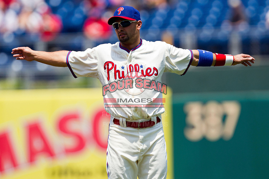 Philadelphia Phillies outfielder Shane Victorino #8 warms up before the Major League Baseball game against the Pittsburgh Pirates on June 28, 2012 at Citizens Bank Park in Philadelphia, Pennsylvania. The Pirates defeated the Phillies 5-4. (Andrew Woolley/Four Seam Images).