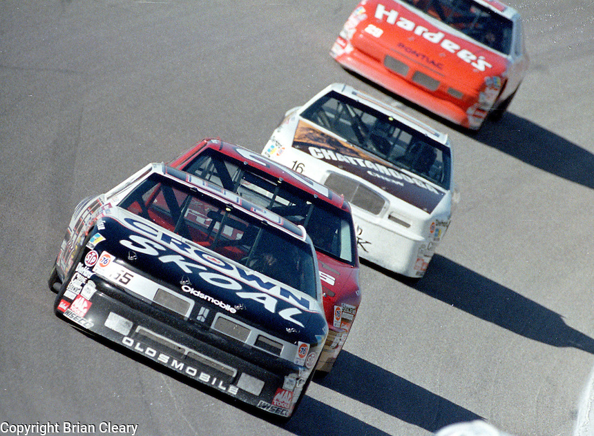 Phil Parsons 55 Ken scrader 25 Larry Pearson 16 Derrike Cope 10 action Winston 500 at Talladega Superspeedway in Talladega , AL in May 1989.  (Photo by Brian Cleary/www.bcpix.com)