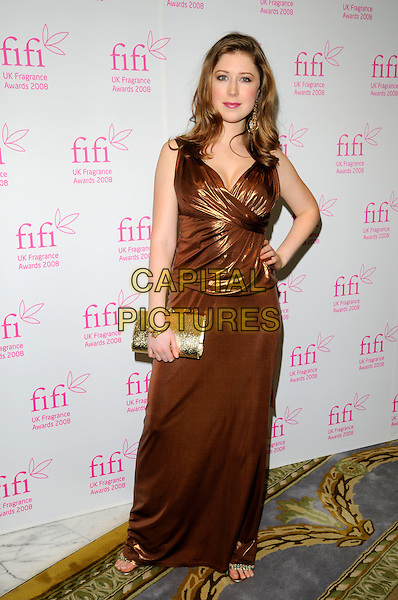 HAYLEY WESTENRA.The FIFI UK Fragrance Awards 2008 at the Dorchester Hotel, Park Lane, London, England..April 23rd 2008.full length bronze shiny dress brown metallic gold clutch bag purse hand on hip.CAP/CAN.©Can Nguyen/Capital Pictures.