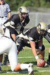 Palos Verdes CA 10/22/10 - Brock Dale (Peninsula #7) and Mickey O'crowley (Peninsula #53) in action during the Leuzinger - Peninsula varsity football game at Palos Verdes Peninsula High School.