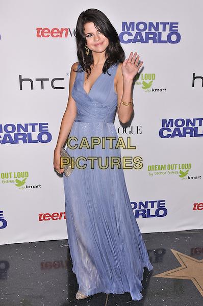"Selena Gomez.""Monte Carlo"" New York Premiere. New York City, NY, USA  23rd June 2011.full length blue sleeveless dress long maxi silver clutch bag hand waving .CAP/ADM/CS.©Chris Smith/AdMedia/Capital Pictures"