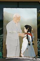 Cholon (Chinatown). Oncle Ho (Ho Chi Minh) billboard.