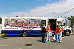 AUG. 11, 2012 - MERRICK, NEW YORK, U.S. - After the barbecue American Legion Merrick Post 1282 hosts for vets from Long Island State Veterans Home at Stony Brook University, a Freedom Express bus, patriotically decorated in red, white and blue, transports guests back to the home.