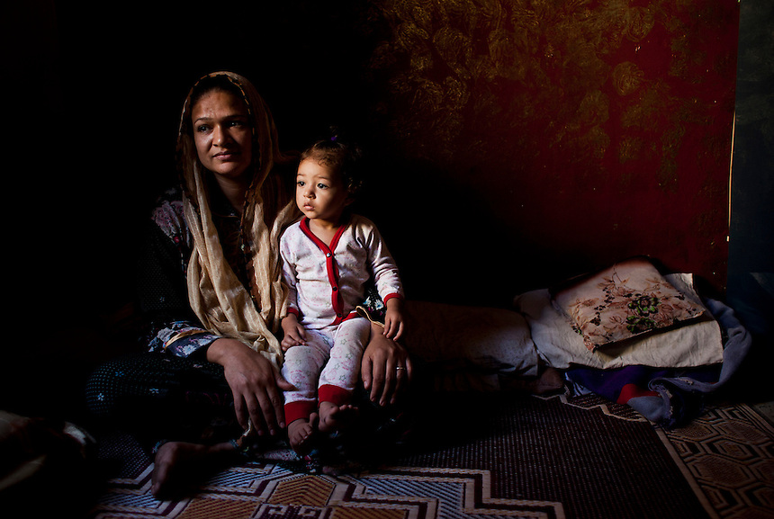 A resident of Cairo's 'city of the dead' sits in her home, Cairo, Egypt, October 2011. Approximately four million people, the population of the city of Sydney, Australia, live in the necropolis in the suburbs of Cairo. Photo: Ed Giles.