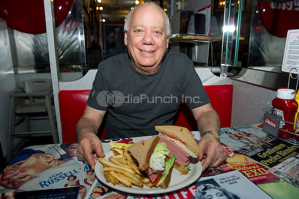 Jeffrey N. Gildenhorn, owner of the American City Diner, 5532 Connecticut Ave, NW; Washington, DC 20015, shows his latest creation, the Trump Sandwich: Full of Bologna, at the diner in Washington, DC on Tuesday, August 11, 2015.<br /> Credit: Ron Sachs / CNP/MediaPunch<br /> (RESTRICTION: NO New York or New Jersey Newspapers or newspapers within a 75 mile radius of New York City)