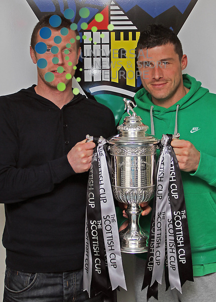 Andy Kirk(L) and Austin McCann(R) hold up the Scottish Cup ,ahead of Dunfermline Athletics Scottish cup tie against Aberdeen..At Pitreavie Training Ground,Dunfermline Accademy of Sport, Dunfermline...Picture, Craig Brown /Universal News and Sport (Scotland)..Tuesday 1st February 2011.