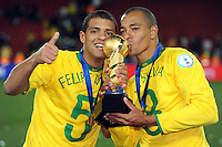 Gilberto SIlva and Felipe Melo of Brazil celebrate with the Confederations Cup. Brazil defeated USA 3-2 in the FIFA Confederations Cup Final at Ellis Park Stadium in Johannesburg, South Africa on June 28, 2009.