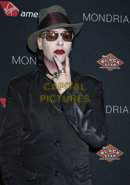 Marilyn Manson (Brian Hugh Warner).5th Annual Sunset Strip Music Festival Held At  SkyBar at Mondrian, West Hollywood, California, USA, .17th August 2012..half length green hat make-up red lipstick sunglasses neck black face paint hands rings hands fingers gesture v sign jacket .CAP/ADM/RE.©Russ Elliot/AdMedia/Capital Pictures.
