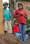 Village near Tegucigalpa, Honduras. Hondoran mother, son, and daughter.